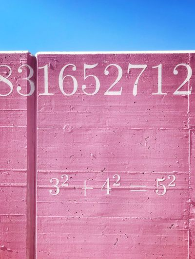 Text Communication Western Script Pink Color No People Close-up Blue Capital Letter Sign Clear Sky Symbol Textured  Wall - Building Feature Wall Outdoors The Minimalist - 2019 EyeEm Awards The Creative - 2019 EyeEm Awards
