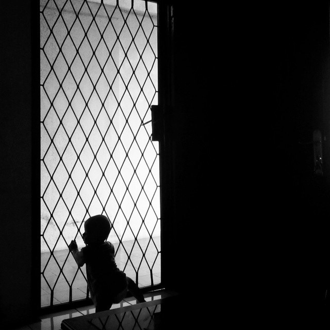 one person, real people, window, childhood, full length, silhouette, architecture, day, built structure, lifestyles, indoors, standing, city, people