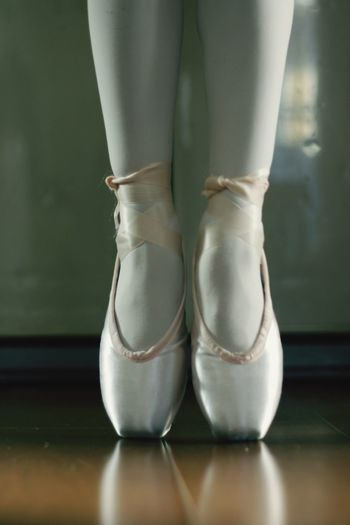 Low section of ballerina tiptoeing