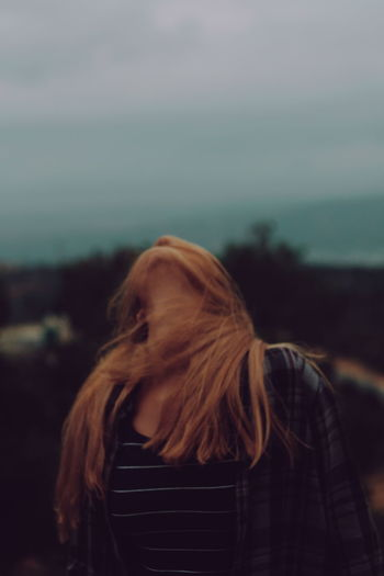 Long Hair One Person People Rear View One Woman Only Only Women Adults Only Wind Adult Redhead Leisure Activity Standing Headshot Outdoors One Young Woman Only Sea Women Sky Day Close-up The Week On EyeEm Second Acts