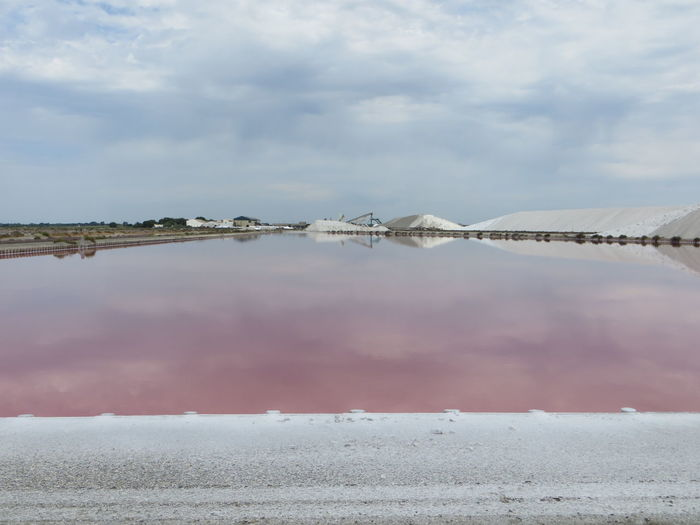 Mountains of salt and pools of purple salt in reflection Cloud - Sky Water Sky Scenics - Nature Tranquil Scene Tranquility Day No People Beauty In Nature Nature Salt Flat Cold Temperature Salt - Mineral Reflection Mineral Lake Winter Non-urban Scene Outdoors Lagoon Pools  Mountain Salt