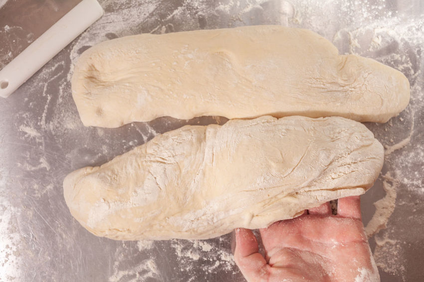 shaping and preparing loaves of bread by hand Care Cutting Natural Bakery Baking Bread Ciabatta Close-up Dough Preparation Flour Food Gluten Home Baking Loaves Nutrition Proof Rise Shaping Sourdough Steel Surface Studio Shot