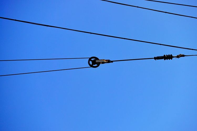 Low Angle View Of Pulley And Cables Against Clear Sky