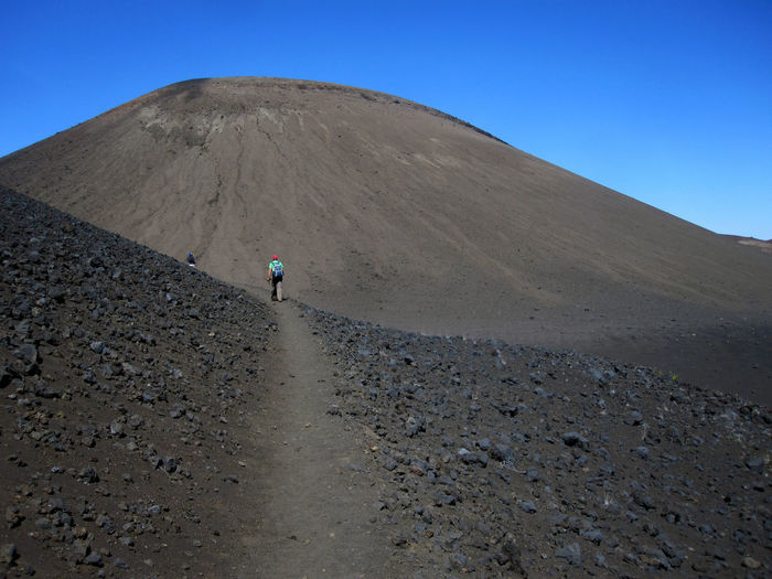 Hawaii Maui Mountain Scenics - Nature One Person Land Nature Blue Landscape Day Sky Beauty In Nature Men Leisure Activity Travel Non-urban Scene Environment Desert Tranquil Scene Geology Physical Geography Outdoors Arid Climate Climate Volcanic Crater Mountain Peak
