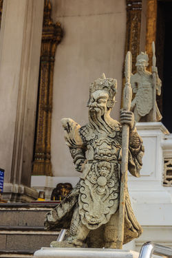 Cute stone of Chinese arts statue in Wat Suthat Temple, Bangkok, Thailand. Chinese Art Chinese God Chinese Doll Wat Suthat Wat Suthat Thepwararam Angel Architecture Art And Craft Belief Building Built Structure Carving - Craft Product Chinese Art & Design Chinese Art And Craft Chinese Dolls Chinese Wall Chinese Warrior Chinese Warrior Statue Craft Creativity Day History Human Representation Male Likeness No People Place Of Worship Religion Representation Sculpture Spirituality Statue Stone Of Chinese The Past