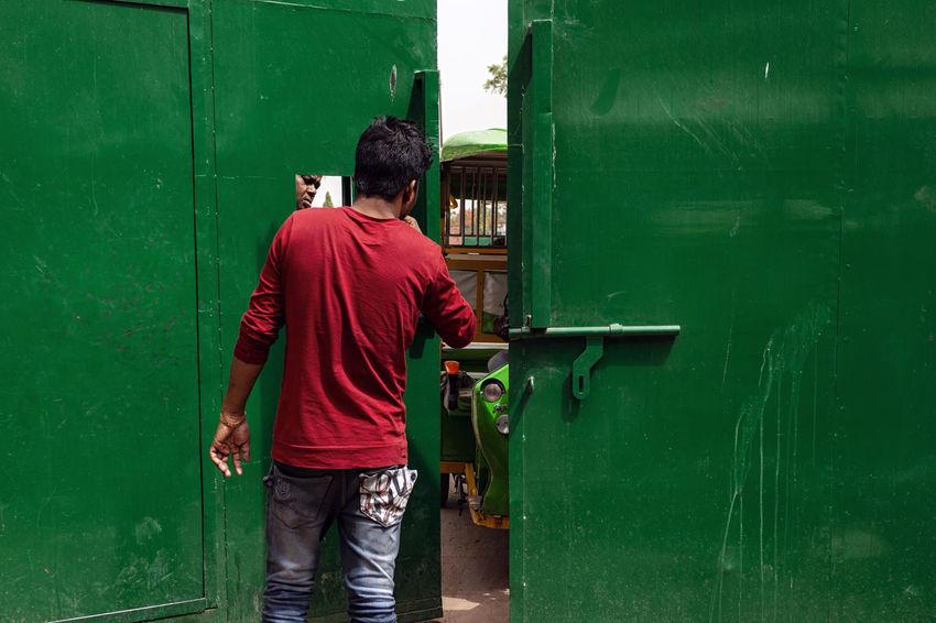 Delhi EyeEm EyeEm Selects EyeEm Gallery Moments Door Eye4photography  Green Color Lifestyles Occupation Outdoors Real People Rear View Red Standing Street Streetphotography Week On Eyeem Weekend Activities