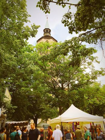 Farmer's market Church Tower Trees And Sky Market Stalls Group Of People Brunswick Braunschweig
