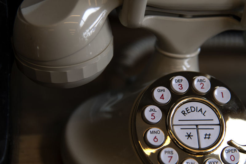 High Angle View Of Retro Style Landline Phone On Table
