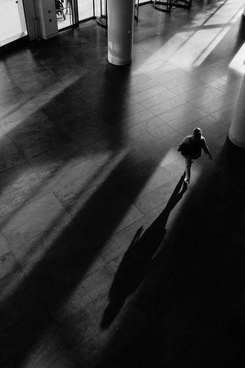 High angle view of man shadow on floor