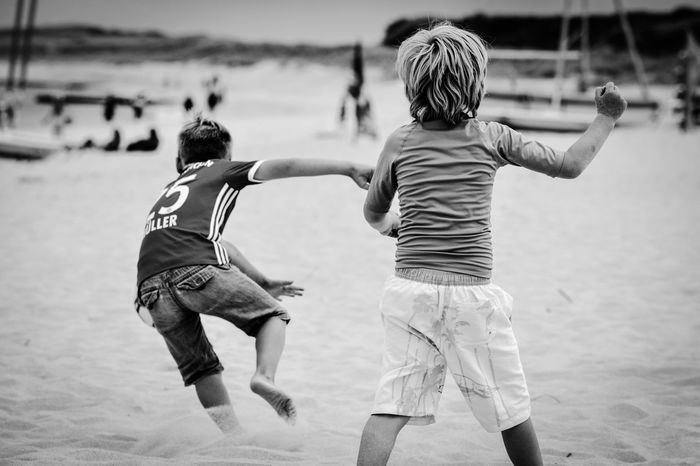 Real People Rear View Childhood Two People Leisure Activity Boys Fun Casual Clothing Playing Focus On Foreground Lifestyles Full Length Sand Girls Day Outdoors Togetherness Beach