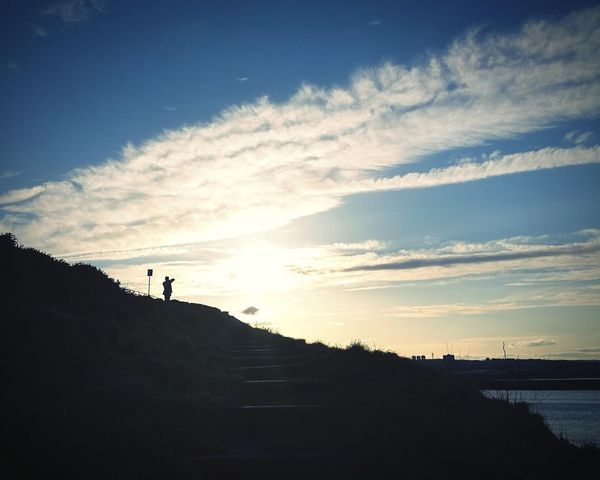 Sky Sky And Clouds Cloud - Sky Cloud Hill Lonely Tranquility Light And Shadow Light Shadows & Lights Dramatic Colours Contrast Nature Sunset Climbing Adventure Men Healthy Lifestyle Silhouette Standing Calm Coast Cliff Tranquil Scene Uphill
