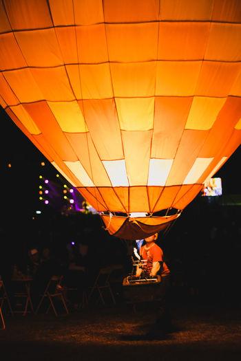 Balloon. Festival Festival Season Balloons Hot Air Balloon Party - Social Event Nightlife Nightclub Celebration Sunset Balloon Illuminated Full Length Enjoyment Music Concert Festival Goer