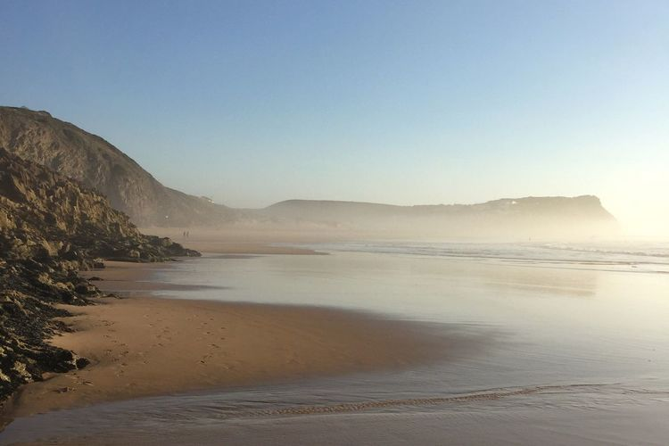 Nature Tranquility Beach Scenics Beauty In Nature Clear Sky Tranquil Scene Sand Sea Non-urban Scene Outdoors Landscape Water Sky No People Day Mountain Low Tide Lonely Loneliness Life Is A Beach Beach Life Monte Clerigo Costa Vicentina Atlantic Ocean