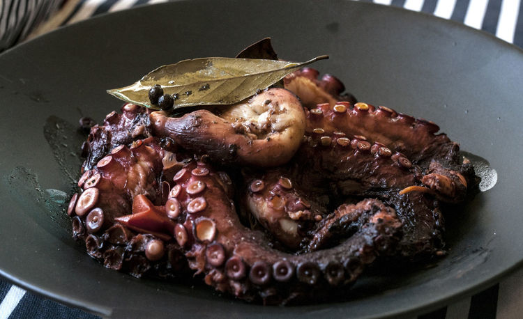 Octopus cooked with red wine, vinegar, bay leafs,Indian pepper, olive oil... Fasting Food Food Photography Foodphotography Greek Cuisine Greek Food Meal Octopus Recipe Visual Feast