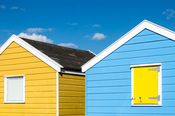 Beach Huts Recreation  Architecture Beach Huts Blue Building Exterior Built Structure Cloud - Sky Coastal Day No People Outdoors Seaside Shelter Sky Southwold Suffolk Wooden Yellow