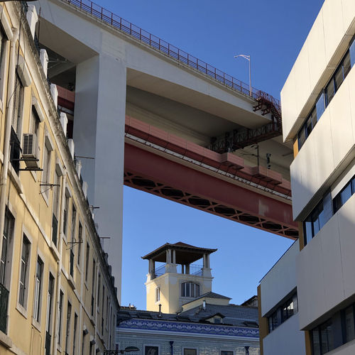 Low angle view of bridge over residential neighbourhood in Lisbon, Portugal Lisbon Portugal Architecture Building Exterior Built Structure Low Angle View Building Sky Day Nature No People Sunlight Clear Sky Residential District City Outdoors Window Blue Balcony Roof House