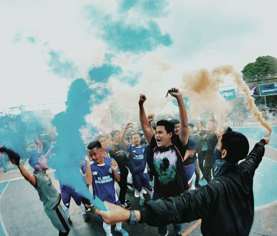 The Photojournalist - 2017 EyeEm Awards Pyro Flare Supporters Team Football Futsal Gangsta Fun Funny Moment Juara Champions People Medium Group Of People Young Men Fun Enjoyment Celebration Friendship
