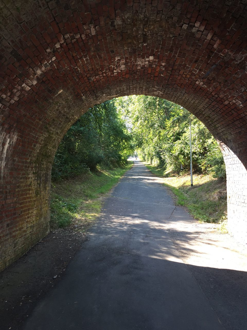 the way forward, direction, arch, architecture, road, day, tree, nature, no people, transportation, tunnel, plant, diminishing perspective, built structure, sunlight, outdoors, empty, shadow, vanishing point, footpath, light at the end of the tunnel