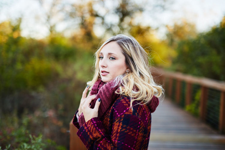 Adult Autumn Beautiful Woman Beauty Beauty In Nature Blond Hair Day Focus On Foreground Leisure Activity Lifestyles Long Hair Nature One Person Outdoors People Portrait Real People Standing Tree Young Adult Young Women