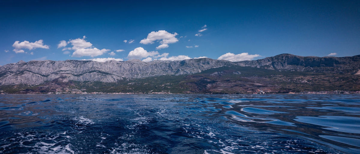 Panorama of mountain Biokovo in Croatia from the sea on the sunny summer day Croatia Mediterranean  Panorama Scenic Travel Adriatic Beauty In Nature Biokovo Blue Day Landscape Makarska Makarska Riviera Mountain Mountain Range Nature No People Nobody Outdoors Scenics Sky Summer Tranquility Water Waterfront