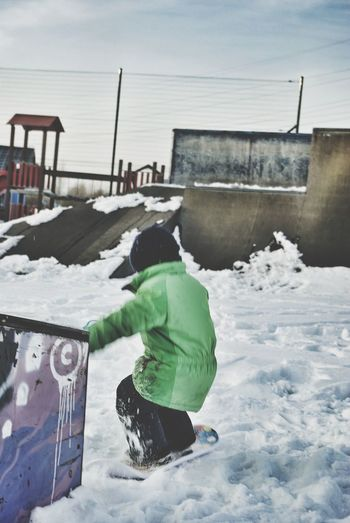Skatepark Snowskate Winter Winter Sports Kids Sports Photo Snow Sports Fun Leisure Activity Jumping Outdoors Cold Temperature Drop Off Motion Snow Day Balance Warm Clothing Child