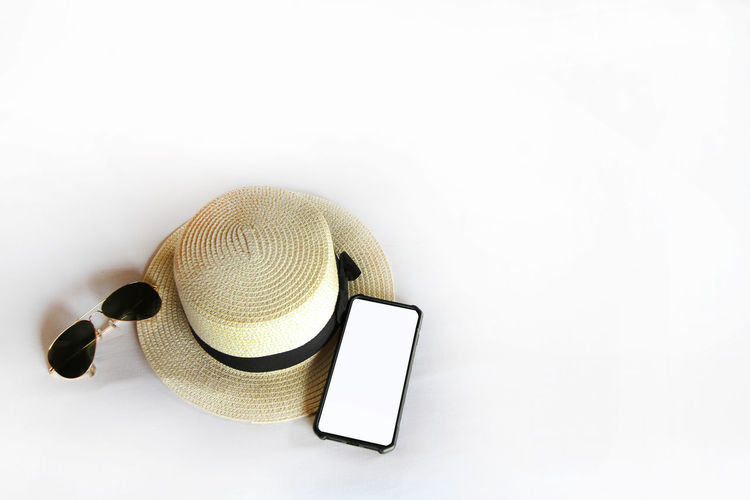 High angle view of smart phone over white background