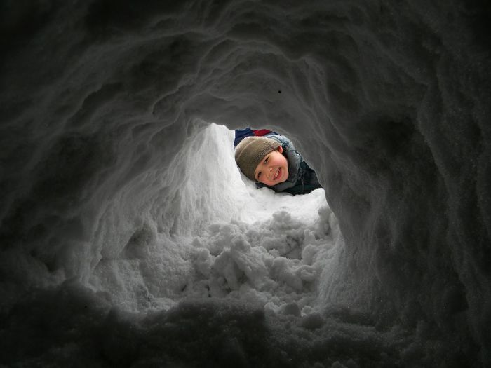 Portrait of boy playing on snow