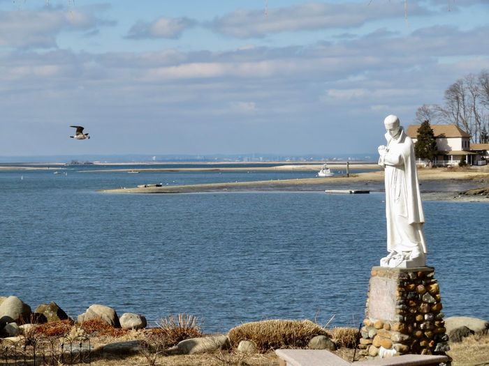 Bird Flight Religious  Prayer Statue Water Sky Sea Human Representation Nature Outdoors Statue