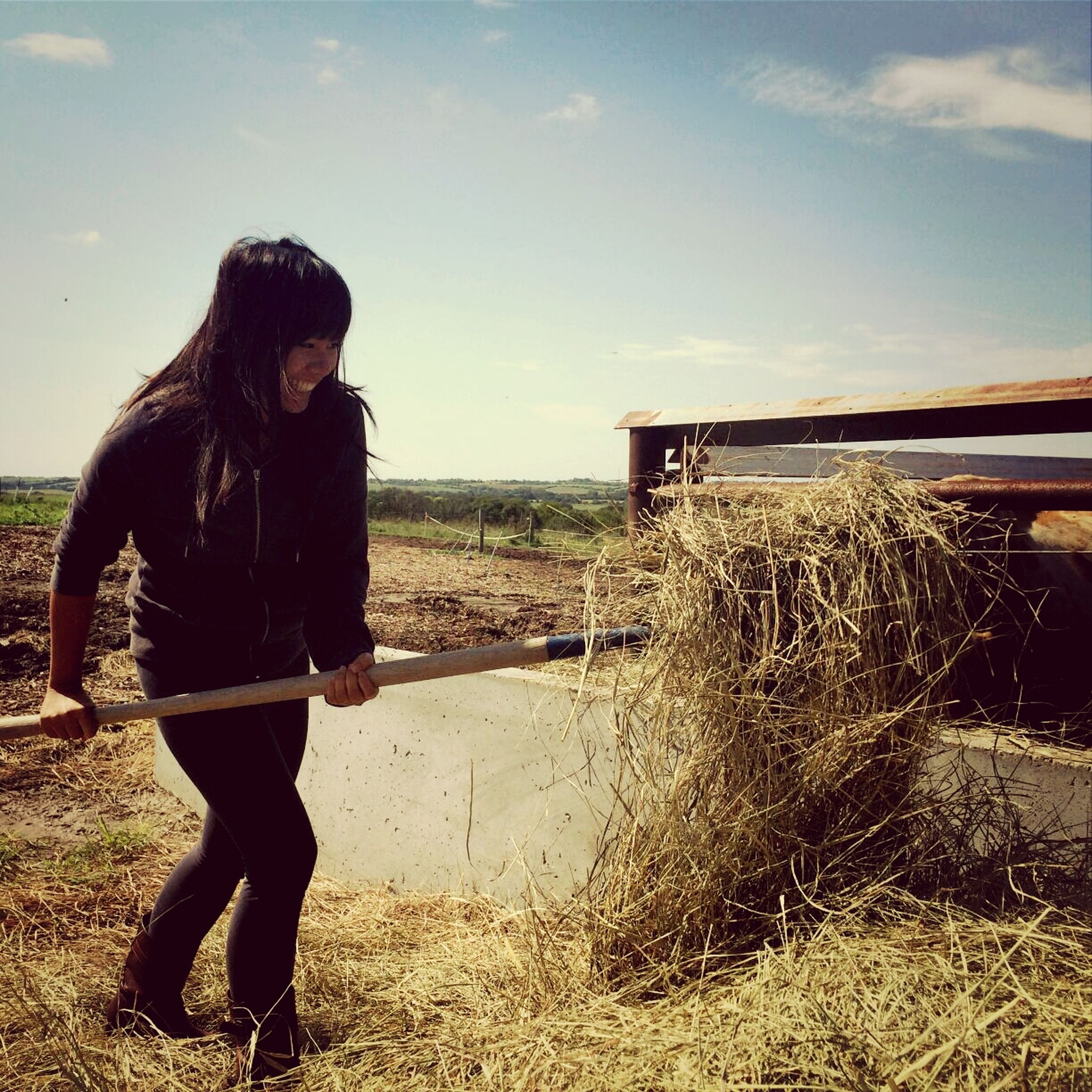 lifestyles, sky, standing, leisure activity, casual clothing, full length, field, young adult, young women, side view, person, landscape, rear view, three quarter length, long hair, outdoors, rural scene