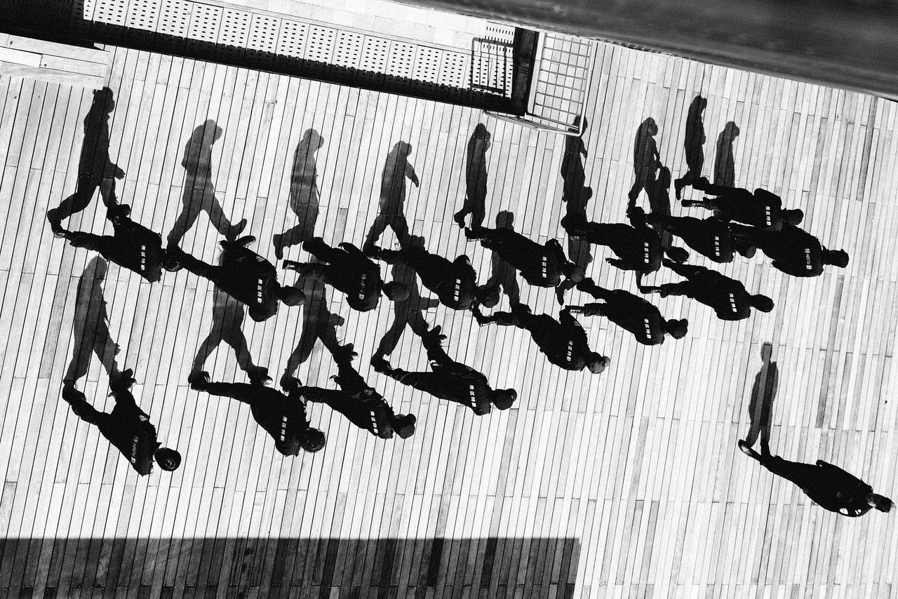group of people, real people, indoors, large group of people, shadow, men, high angle view, adult, women, crowd, flooring, walking, architecture, day, leisure activity, full length, shoe, lifestyles, arms raised