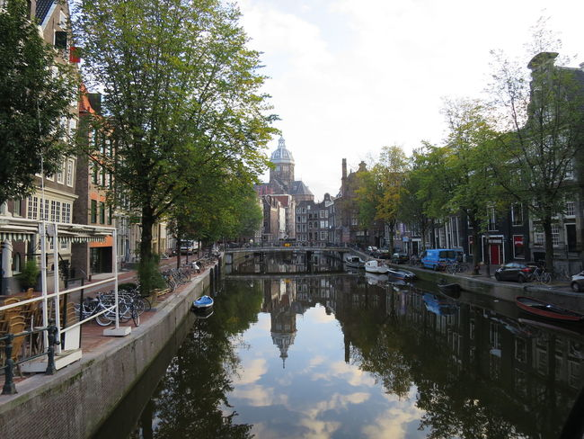 Amsterdam Amsterdam Canal Amsterdamcity Amsterdamse Grachten Bicycles Building Exterior Canal Church City Life Cityscape Nautical Vessel Perspective Reflexions Residential District Tree Urban Water Water Reflection Water Reflections