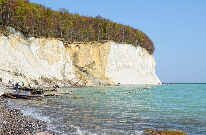 Scenic view of sea by chalk cliff