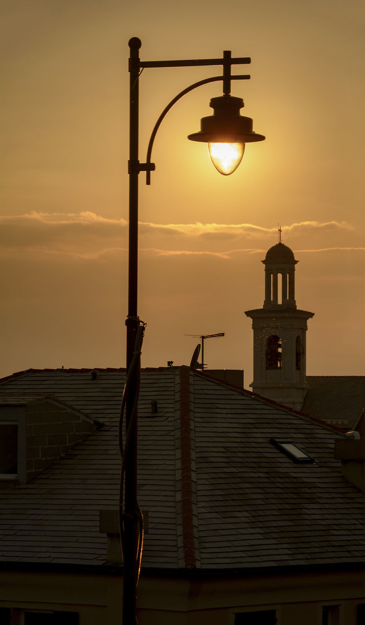 Low Angle View Illuminated Street Light Against Building