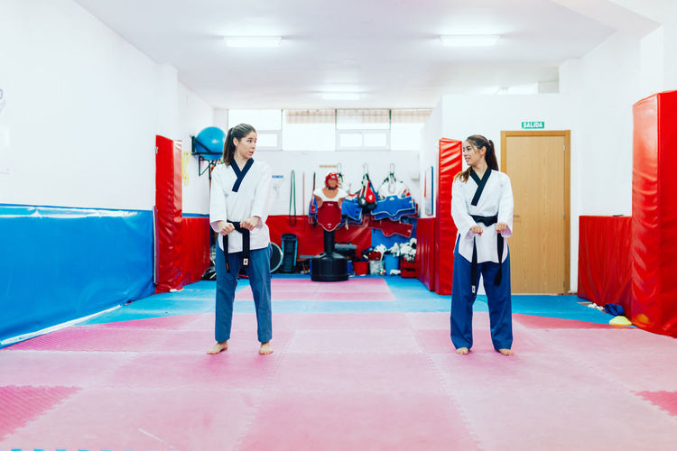 Women practicing martial art in gym