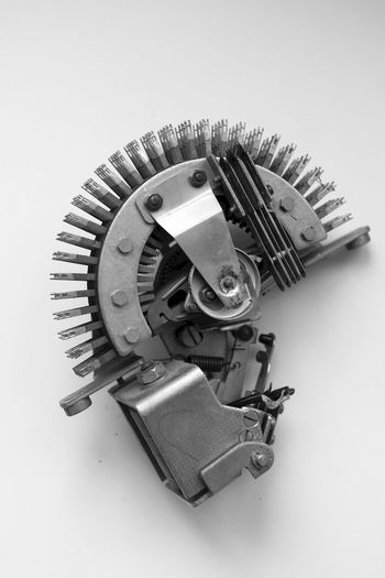 Close-up of machine part over white background