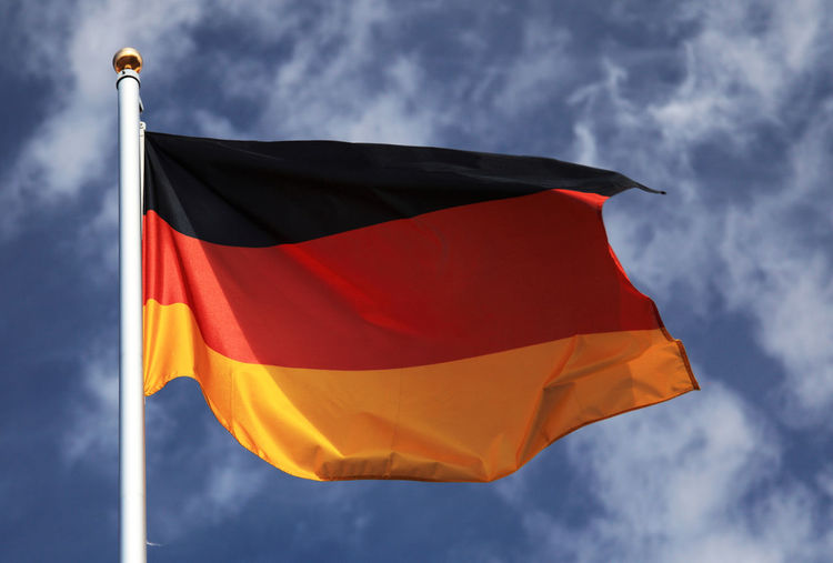 Low Angle View Of German Flag Waving Against Sky