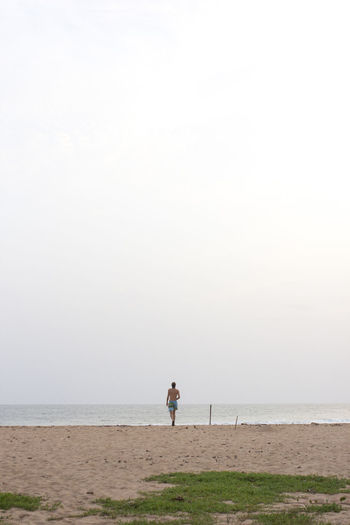 Adult Africa Beach Beach Photography Day Full Length Ghana Horizon Over Water Minimal Minimalism Nature One Man Only One Person Outdoors Real People Sand Scenics Sea Sky Standing The Great Outdoors - 2017 EyeEm Awards Tranquil Scene Tranquility Vacations Water