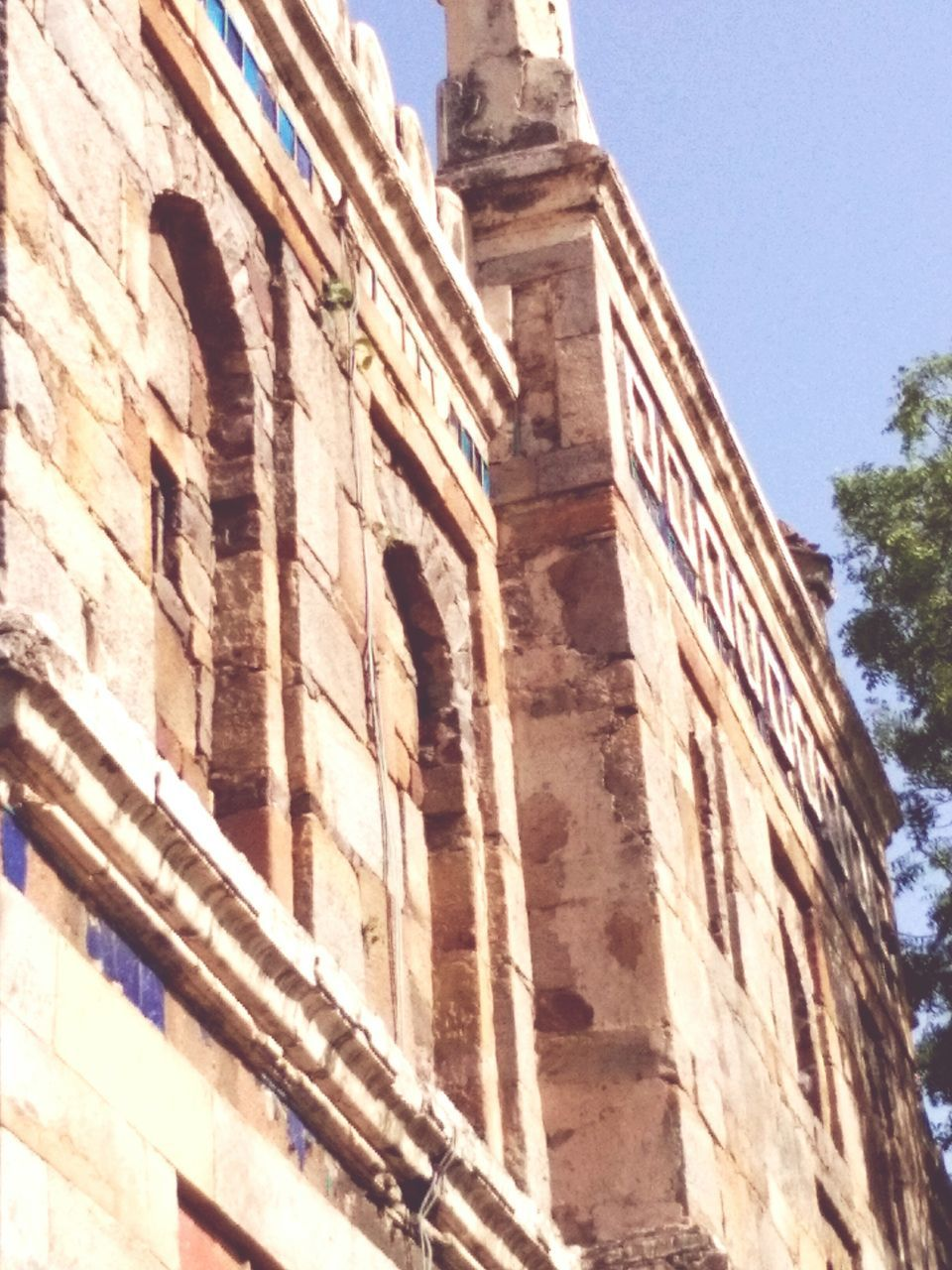 low angle view, architecture, built structure, history, building exterior, no people, outdoors, day, sky, ancient civilization