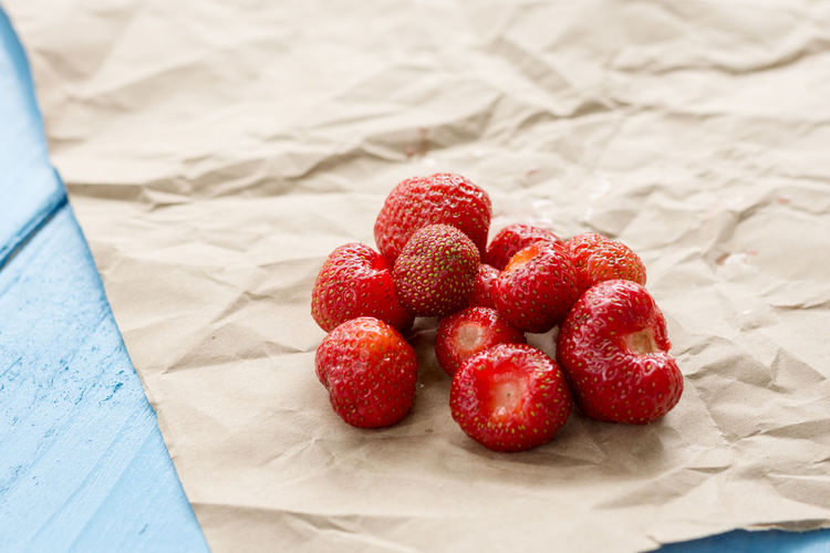 Fresh sweet red strawberries on the brown paper. Blue Table Brown Paper Delicious Delicious Food Food Fresh Food Fresh On Eyeem  Freshness Fruit Healthy Eating No People Paper Red Red Color Selective Focus Strawberry Strawberry Love Sweet Sweet Food