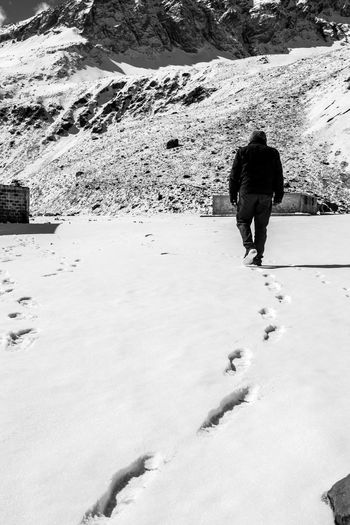 One Person Rear View Full Length Adult One Man Only Only Men Snow Adults Only Winter Day People Outdoors Standing Real People Nature Men Cold Temperature Black And White Sunlight Narure_collection Beauty In Nature Adults Only Adult FootPrint