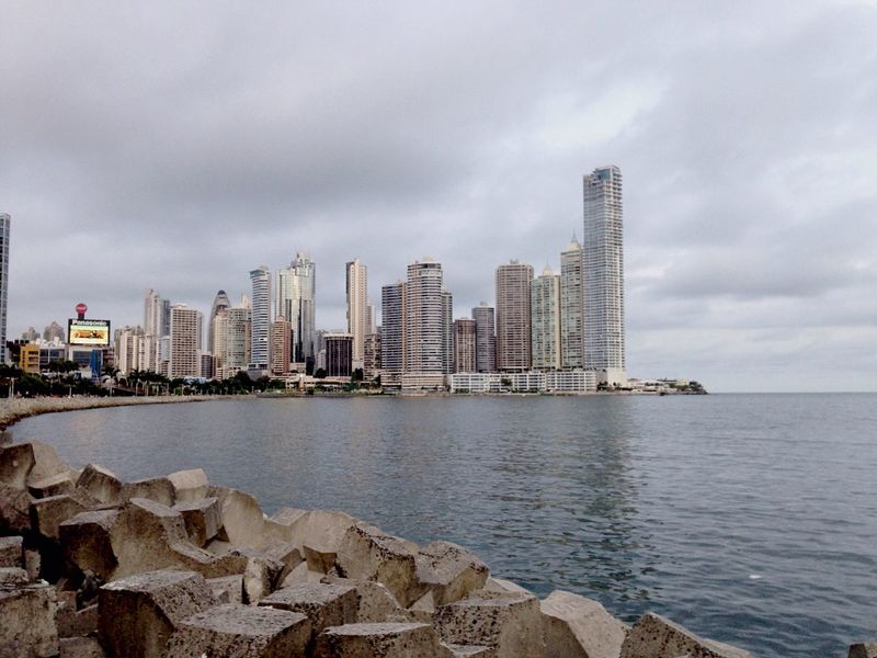 Architecture Water Built Structure City Building Exterior Sky Sea Cloud Skyscraper Tall Cloud - Sky Day Tall - High Development Cloudy Urban Skyline Tranquil Scene Outdoors City Life Scenics