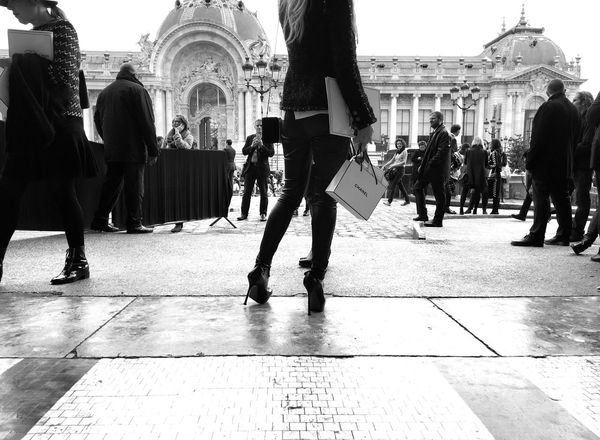 A Woman in Heels Waits outside the Chanel SS16 Fashion Show during Paris Fashion Week shot on IPhone 6s