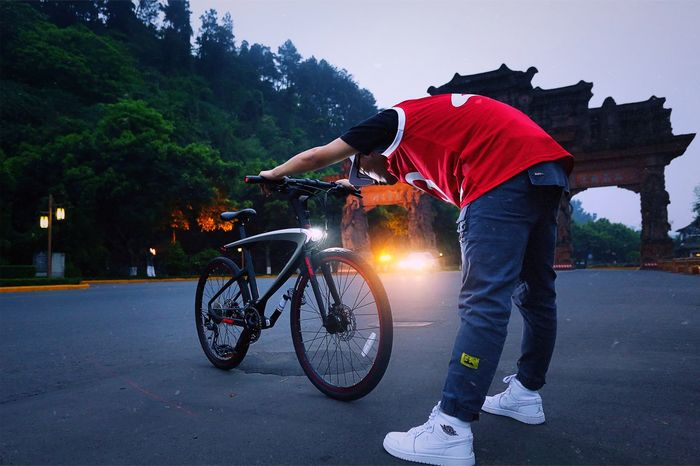 Sichuan Leshan, China Bicycle Only Men Young Adult Adults Only Cycling Outdoors Tree People One Person Adult Night One Man Only Cityscape Illuminated Men Sky Headwear Bmx Cycling