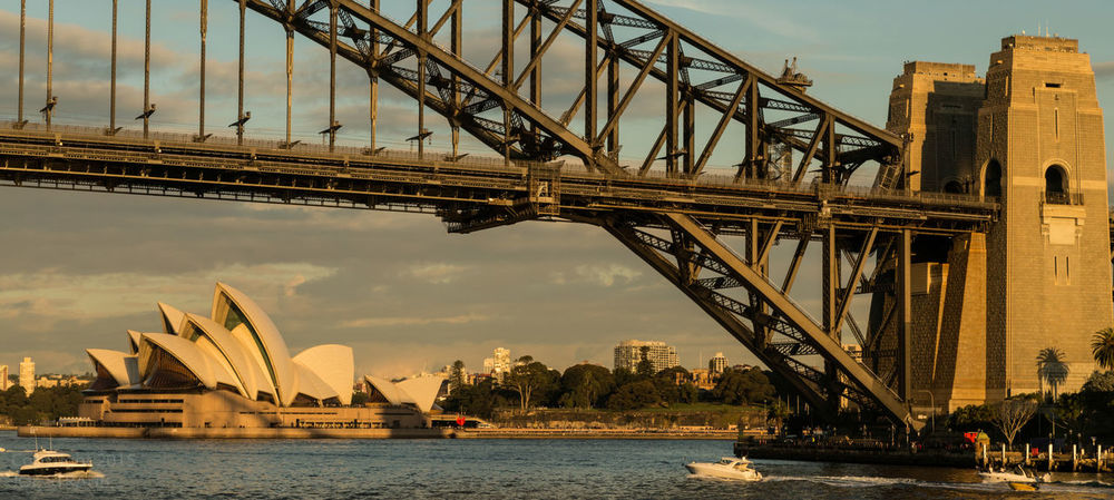 Architecture Boat Bridge - Man Made Structure Building Exterior City City Cityscape Cultures Day Harbor No People Outdoors Steel Sunset Sydney Harbour Bridge Sydney Opera House Travel Travel Destinations Tree Water