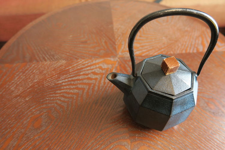 High angle view of teapot on table