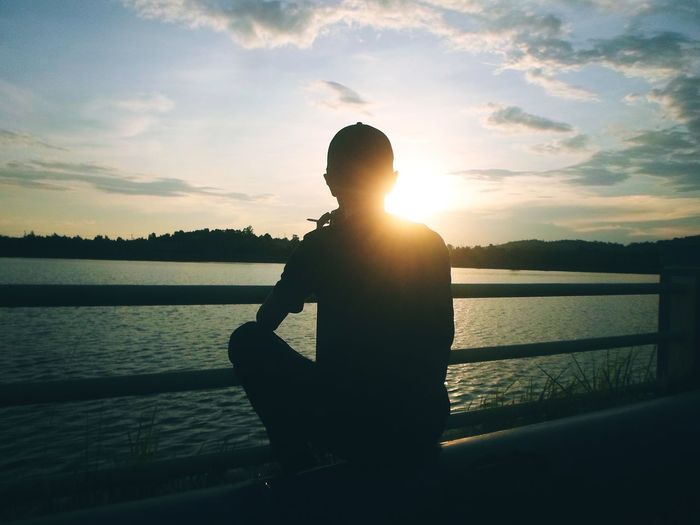 One Man Only Silhouette Sunset Water People Back Lit Outdoors Cloud - Sky Lifestyles Nature Human Body Part EyeEmNewHere