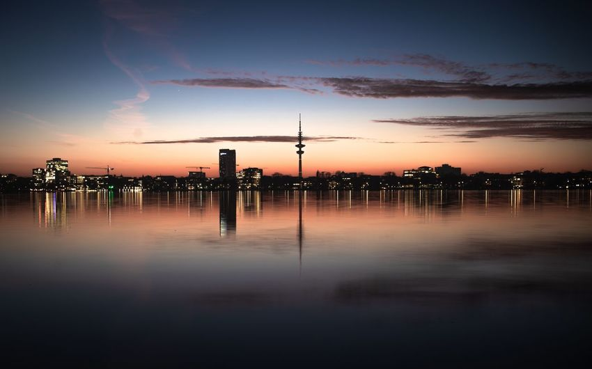 Heinrich-Hertz-Turm Long Exposure Dramatic Sky Hamburg Alster Heinrich-Hertz-Turm Sunset Sunset Water Cloud - Sky Silhouette Nature Reflection