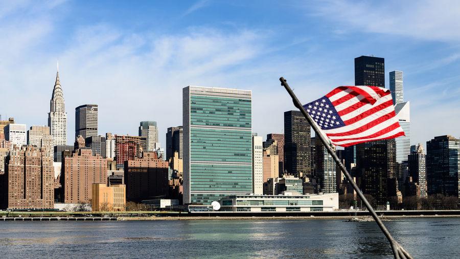 American flag against city skyline