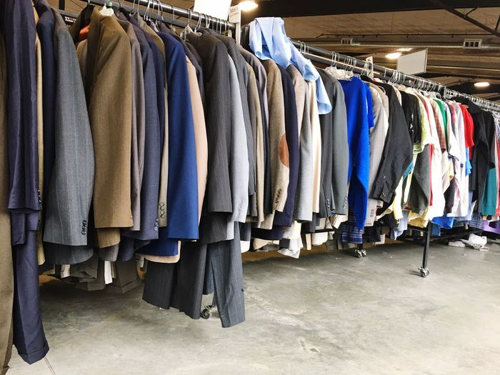 Men's rack at the thrift store Thrift Store Mens Clothes Hanging Clothing Choice Retail  Textile Arrangement Variation Rack Business Shopping In A Row