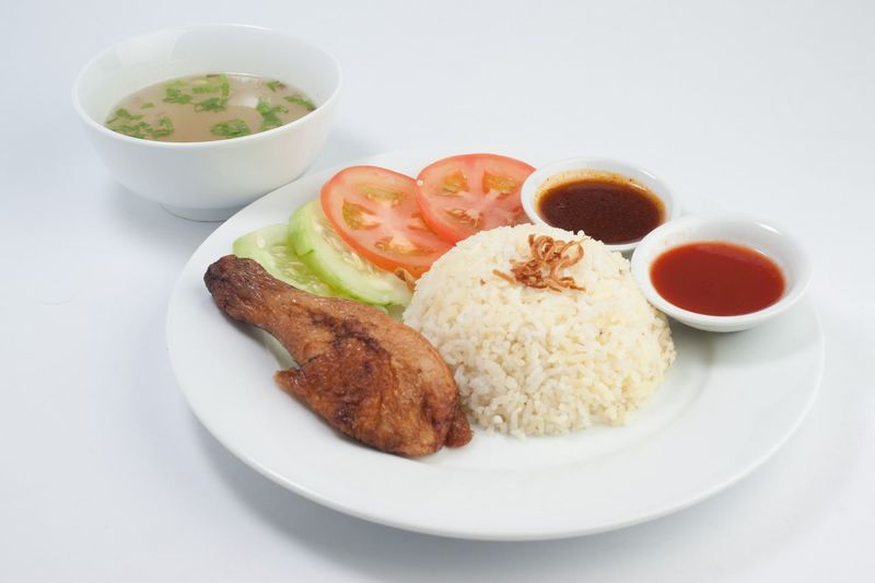 Fried Chicken Served With Steamed Rice And Salad